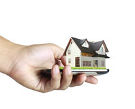 House on a mobile phone, in hand Stock Photo