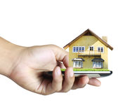 House on a mobile phone, in hand Stock Image