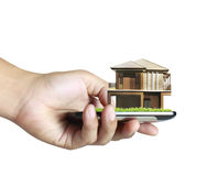 House on a mobile phone, in hand Stock Photos