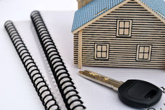 House mode, key and documents. House model, key of the house and document which descripte the house, as concept of receiving the house, or real estate Stock Images