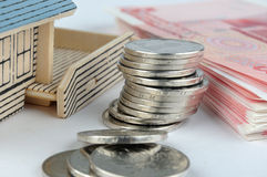 House model with bill and coins Royalty Free Stock Photo