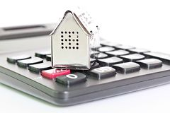 House model and calculator on office desk table stock photos
