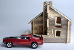 House model and car model. A house model with a small car toy in front. means home, life, future, consume, expense and real estate Royalty Free Stock Image
