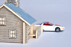 House model and car toy. A house model with a small car toy. means home, life, future, consume, expense and real estate Stock Images