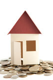 House model with coins Stock Images