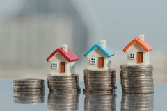 House model on coins stack. planning savings money of coins to buy a home concept royalty free stock photography