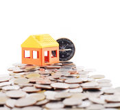 House model and compass. On coins background Stock Image