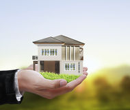 House model concept in  hand Stock Photos