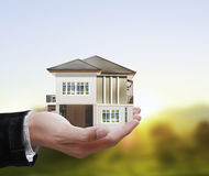 House model concept in  hand Stock Photography