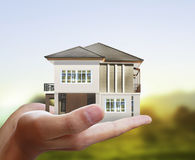 House model concept in  hand Stock Images