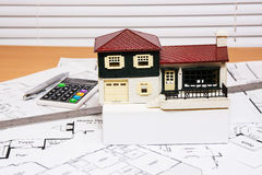 House model on construction blueprints Stock Image