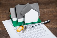 House Model And Contract Paper Stock Photos