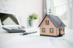 House model on desk, mortgage or house building concept Royalty Free Stock Images