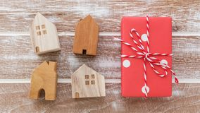 House model with gift box. On wooden table background from top view Royalty Free Stock Images