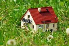 House model in grass Stock Photos