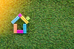 House model on grass texture royalty free stock image