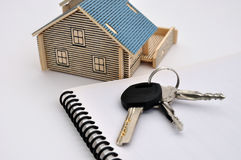 House model, keys and document Stock Photo