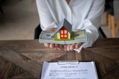 House model and money in hand royalty free stock photo