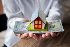 House model and money in hand royalty free stock images