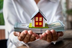 House model and money in hand. Concept of real estate and deal royalty free stock images