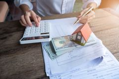 House model and money in hand, Concept of real estate and deal stock photography