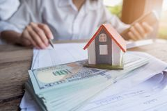 House model and money in hand, Concept of real estate and deal royalty free stock photo