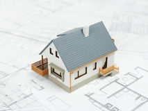 House model over blueprints Royalty Free Stock Images