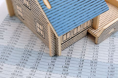 House model and price data. House model and the price of house market increase and drop Stock Photos