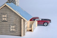 House model and a red car toy. A house model with a small car toy behind. means home, life, future, consume, expense and real estate Royalty Free Stock Images