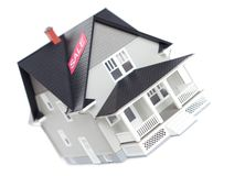 House model with sale sign, isolated Royalty Free Stock Image