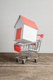 House model in shopping cart Royalty Free Stock Image