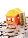 House model and stack coin on many coins background. House model and stack coin on white background Stock Images