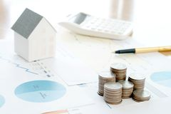 With House Model And Stack Of Coins stock photo