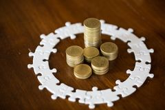 House model on stack coins.Jigsaw puzzle, Saving money and property Management concept royalty free stock image