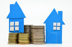 House model and stacks of coins Stock Images