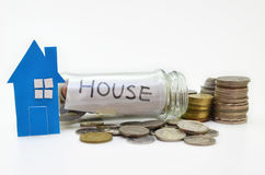 House model and stacks of coins Stock Image