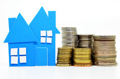 House model and stacks of coins Stock Photography