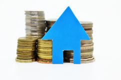 House model and stacks of coins Royalty Free Stock Image