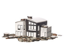 House model standing on american coins Royalty Free Stock Images