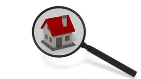 House model under a magnifier Royalty Free Stock Photos