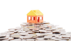House model on way of coins. House model on coins background Royalty Free Stock Image