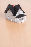 House model on wooden table Stock Photo