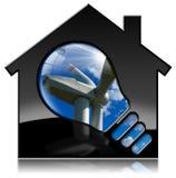 House modelo con la turbina de viento y la bombilla Imagen de archivo libre de regalías