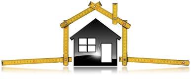 House modelo negro y regla de plegamiento de madera Foto de archivo