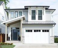 Free House Modern Custom Exterior Home Gray White Siding Stock Photo - 196799230