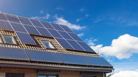 House with solar panels on the roof. House with modern solar panels on the roof Stock Photos