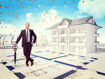 House money. Smiling businessman and 3d house with money rain Royalty Free Stock Photos