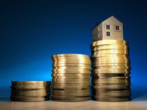 House on money. Conceptual house on a stack of golden coins - 3d render Royalty Free Stock Image