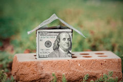 The house from money. On a brick royalty free stock images