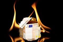 House from money burning. House from euro money burning Stock Photography